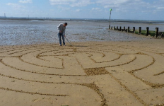 Baptist Minister's beach art creates intrigue